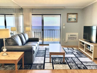 Cozy, stylish 1 bedroom oceanfront condo with free WiFi, comfortable furnishing, and a stunning ocean view located uptown and just steps to the beach!