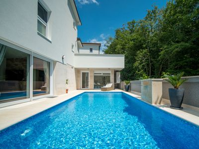 Photo for This 4-bedroom villa for up to 8 guests is located in Dobrinj and has a private swimming pool, air-c