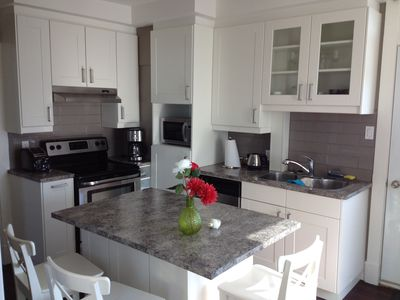 Photo for Quiet apartment in Pointe-Claire Village near water