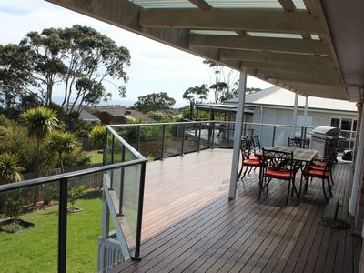 Balcony with an extensive view of the bay and BBQ.  Have your drinks, dinner etc
