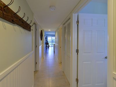 Entry hallway with wains coating and tile floors