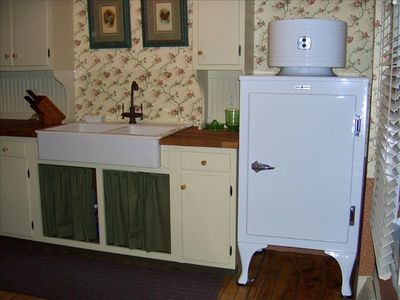 Charming 1930's farmhouse kitchen with restored 1935 GE monitor top refrigerator