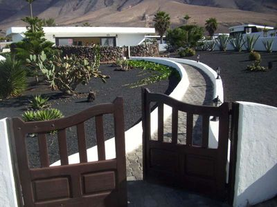 Photo for Bungalow NICOBAR in Famara for 4 persons with terrass, garden, views to the ocean, views of the volcanoes, WIFI on the go and less than 20m to the sea