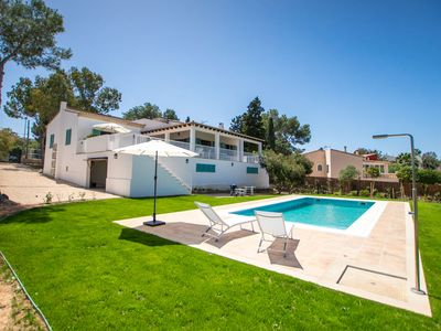 Photo for This 4-bedroom villa for up to 8 guests is located in Cala Blava and has a private swimming pool, ai