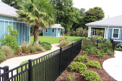 Pet friendly, Property completely fenced in.  Garage on left and storage shed