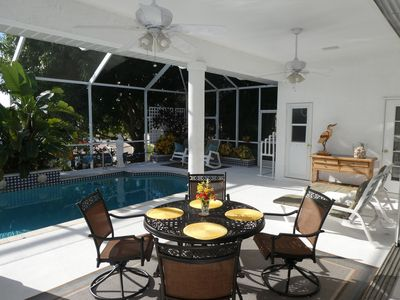Outdoor pool area/lanai.  Swivel rocker chairs.  Extra sitting chairs inside.