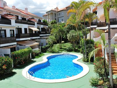 Photo for New Apartment with views, residential area, heated pool + wifi