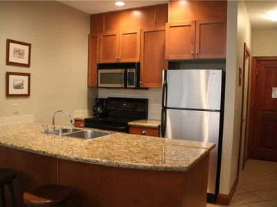Photo for On-mountain condo with kitchen, outdoor pool, hot tubs & BBQ access, 5min walk to ski lifts: T523A