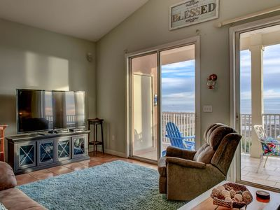 Photo for Top floor condo with great views, shared pools & beach access!