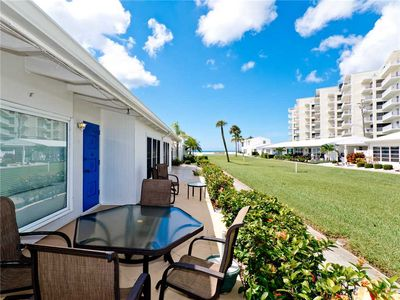 Manicured lawns and a walkway to the beach - Beachaven 52 is so close to the beach, you can walk there in little more time than it takes to read this!