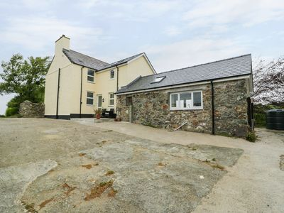 Photo for GWLGRI, pet friendly, with open fire in Church Bay, Ref 985267