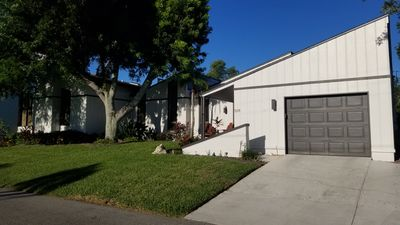 Photo for Beautiful Longboat Home on a Canal with a Pool - 5 minute walk to the Beach!