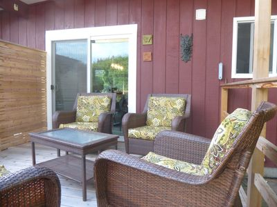 The deck is right off of the dining area next to the kitchen.