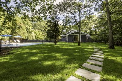 Expansive front lawn with pool