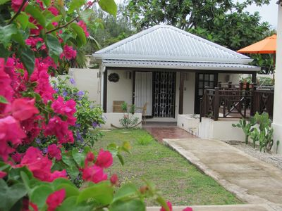 Beautiful cottage within a gated flower garden. All the amenities of home!