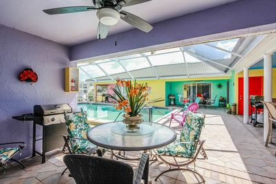 Private lanai w/ table and chairs steps from your heated pool