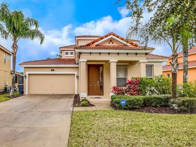 Photo for Delightful Luxury Pool Home, only minutes from Disney - 5BD/4.5BA #5WR510