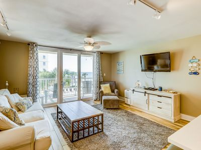 Photo for Beautiful, waterfront condo w/ shared pools, tennis, sauna, gym, & beach access