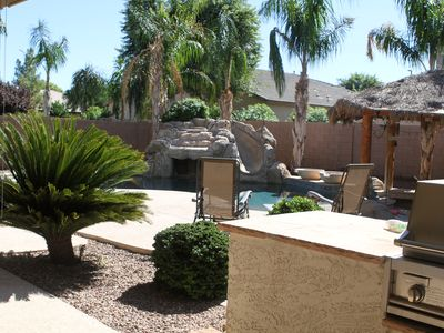 Backyard pool with rock slide