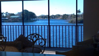 River view from Kitchen, Living and Dining areas of home.Wraparound screen porch