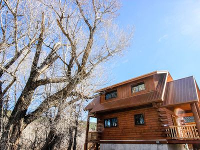 Photo for Cozy riverfront, dog-friendly home close to town in quiet location