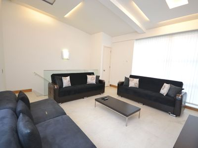 Photo for Bright and Spacious 5 bed apartment perfect for a trip away with a large group of family or friends!