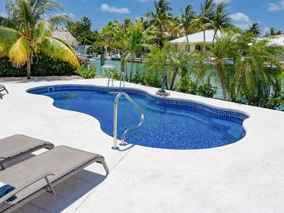 Photo for Canal-Side 4BR Home w/ Large Private Dock, Covered Patio & Waterfront Pool