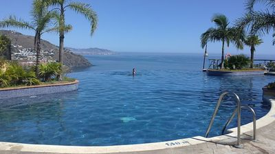 Photo for Excellent views. Beach & mountain. Panorama swimming pool all year round