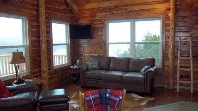 Photo for Rustic Log Cabin nestled in the woods with a magnificent view of Tablerock lake.