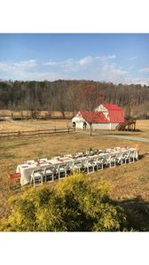 Dining event outdoors in front of farmhouse