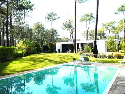 Photo for Contemporary style villa, pool, overlooking golf fairway, near stunning beaches