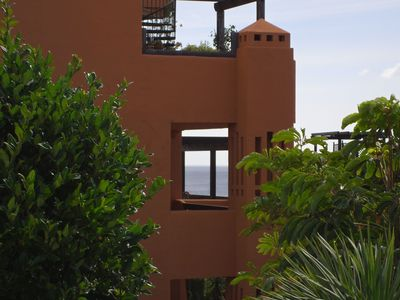 Photo for Lovely apartment complex with pool and tropical gardens. free WIFI