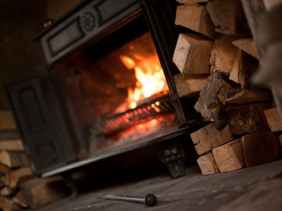 A woodburner ready to keep you toasty during your stay