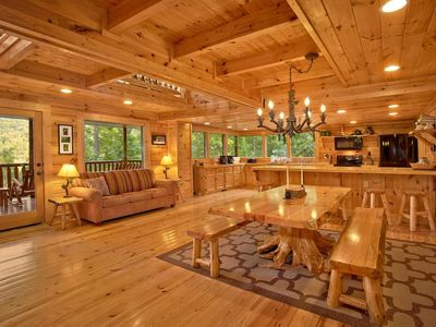 Photo for Roomy cabin with hot tub, four fireplaces, pool table, and free passes to local attractions