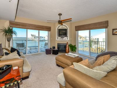 Upscale, stylish 3 bedroom condo with free WiFi, and outdoor pool, and a breathtaking view of the bay located in midtown and only two blocks from the beach!