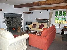 The beautiful beamed sitting room with log burner