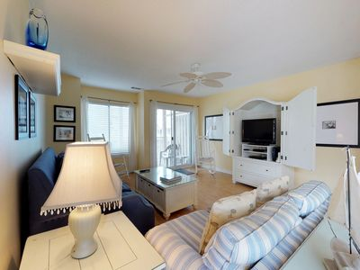 Photo for Multi-level condo with shared pool & tennis court access, walk to the beach