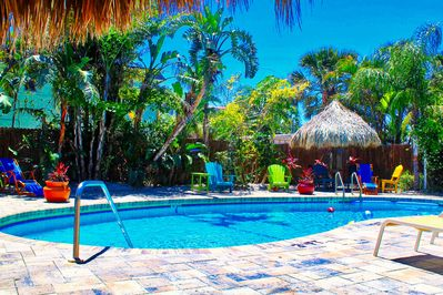 The expansive pool deck with it's Tiki Hut Shade and lounging chairs make for the perfect atmosphere on vacation