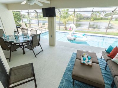 Photo for Well appointed Crown Pointe lake view pool home (w/2 King bedrooms) minutes to downtown & beaches!