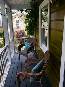 Rain or shine, New Orleans front porch always beckons you to relax