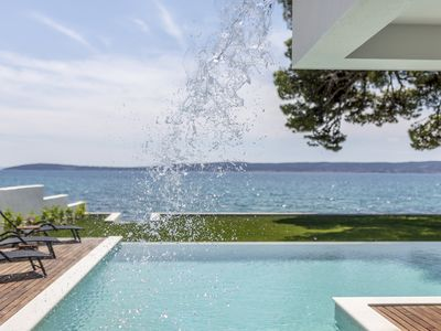 Photo for Villa Sea Star - seafront beach with 80m2 pool, BBQ and car garage.