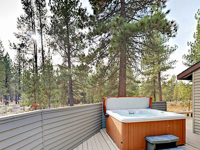 Outdoor Space - Soak in the private hot tub among the trees.