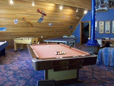 Game Room With Free Standing Wood Fireplace