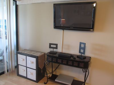Flat Screen TV is mounted in Living Room - DVD and Movies as well as Cable..