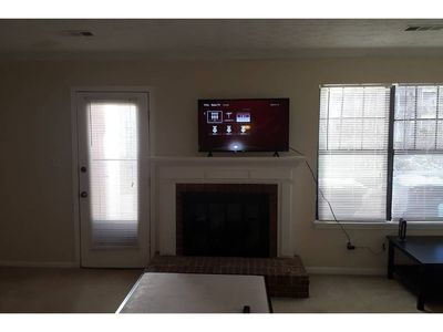 Photo for Cozy townhome w/ queen beds. Walking distance to Avalon.