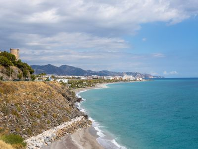 Photo for Renovated apartment w/ terrace & marvelous partial ocean views-close to the sea