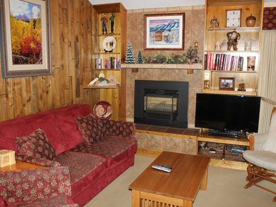 Cozy conversation area features gas fireplace and HD TV.
