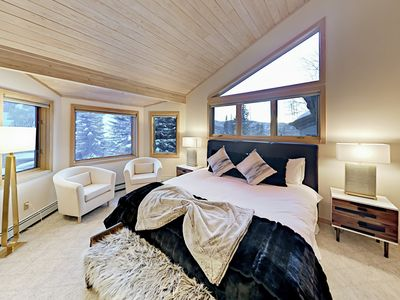 Master Bedroom - The master suite delights with a queen-size bed and a beautiful en-suite bathroom.
