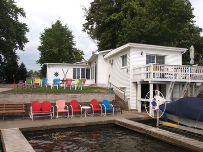 Year round Lake home w/wonderful frontage, nice yard w/ fire pit, home theatre