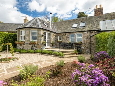 Photo for Lovey cottage with stunning river views - perfect for a romantic getaway